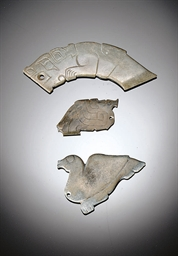 THREE EARLY JADE PENDANTS