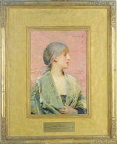 A girl wearing a green shawl
