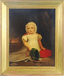 Portrait of a baby holding a g