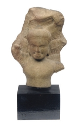 A KHMER SANDSTONE FRAGMENT OF
