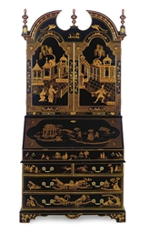 A BLACK AND GILT-CHINOISERIE D