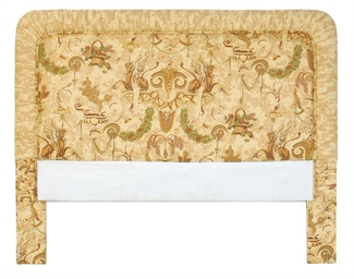 AN UPHOLSTERED HEADBOARD,