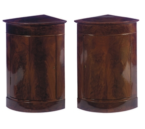A PAIR OF MAHOGANY CORNER CUPB