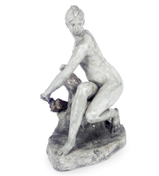 A GLAZED COMPOSITION FIGURE OF
