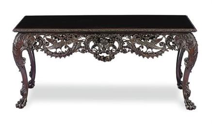 AN IRISH MAHOGANY CENTER TABLE