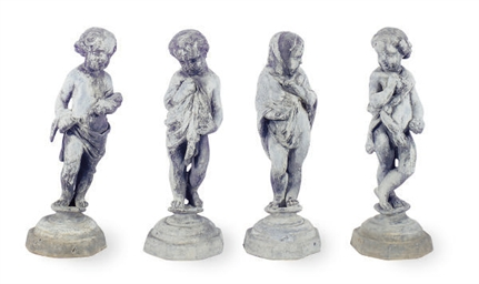 A SET OF FOUR LEAD FIGURES OF