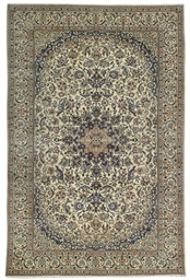 A FINE PART-SILK NAIN CARPET,