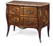 A LOUIS XV GILT-METAL MOUNTED BOIS SATINE AND TULIPWOOD SERPENTINE COMMODE