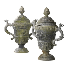 A PAIR OF CAST LEAD URNS