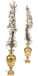 A PAIR OF GILT AND SILVERED BR