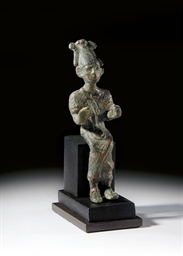 A SYRO-EGYPTIAN BRONZE FIGURE