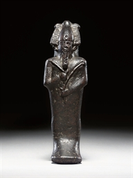 AN EGYPTIAN SERPENTINE FIGURE
