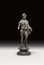 A BRONZE FIGURE OF A PTOLEMAIC