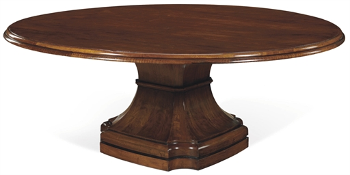A WALNUT DINING TABLE
