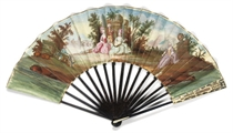A FAN WITH IVORY AND WOOD STICKS