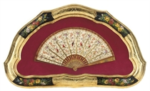 A HORN FAN PAINTED WITH BIRDS