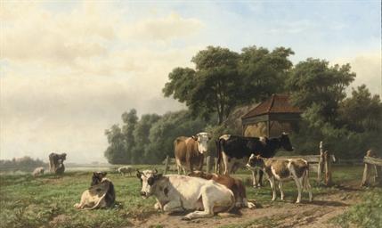 Cows near a haystack