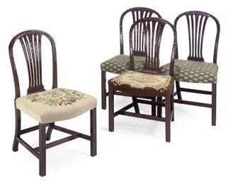A SET OF FOUR MAHOGANY DINING