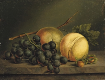 Peaches and grapes on a marble