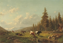 Cattle in the mountains near a stream