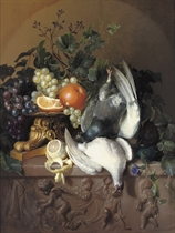 Fruits and poultry on a stone ledge