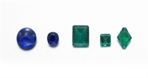 A GROUP OF UNMOUNTED EMERALDS AND SAPPHIRES