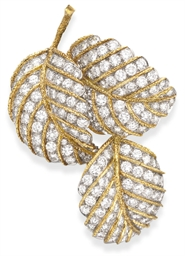 A DIAMOND AND GOLD LEAF BROOCH