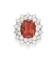 A TOPAZ AND DIAMOND RING, BY T