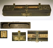 A FATIMID CARVED EBONY AND IVORY PENBOX WITH BRONZE MOUNTS
