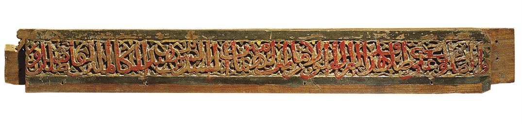 A PAINTED CARVED WOODEN BEAM