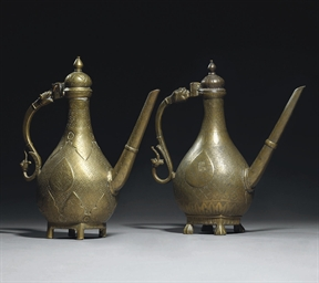 TWO BRONZE EWERS