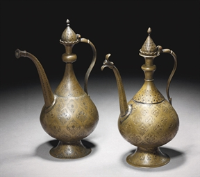 TWO INDIAN BRASS EWERS