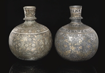 TWO BIDRI SILVER AND BRASS INLAID HUQQA BASES, BIDAR, DECCAN