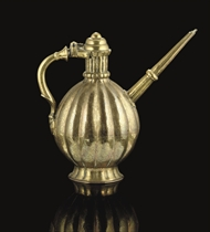 AN ENGRAVED BRASS EWER, NORTH INDIA, CIRCA 1700