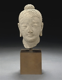 A STONE MODEL OF A HEAD, GANDH