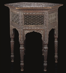 A HEXAGONAL CARVED WOOD TABLE,