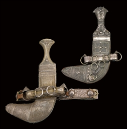 TWO SILVER MOUNTED JAMBIYYAS,