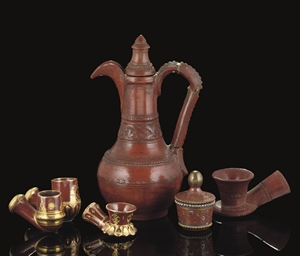 A TOPHANE EWER, FOUR PIPES AND