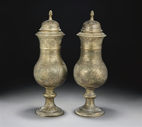 A PAIR OF QAJAR PIERCED BRASS