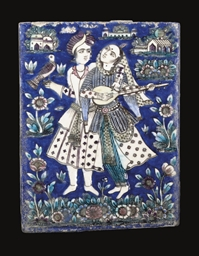 TWO QAJAR MOULDED POTTERY TILE