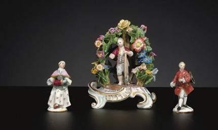 A MEISSEN MINIATURE ARBOR GROUP AND A PAIR OF MEISSEN FIGURE...