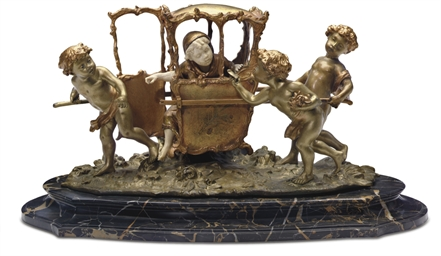 A FRENCH BRONZE AND IVORY GROU