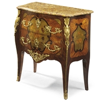 A LOUIS XV ORMOLU-MOUNTED TULIPWOOD, KINGWOOD, HAREWOOD AND FLORAL MARQUETRY BOMBE COMMODE
