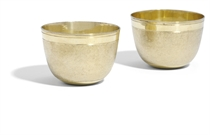 A PAIR OF GERMAN SILVER-GILT TUMBLER-CUPS