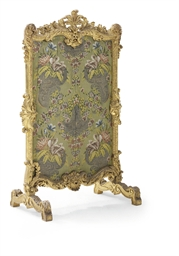 AN EARLY LOUIS XV CARVED GILTW