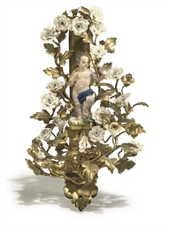 A LOUIS XV PORCELAIN-MOUNTED O