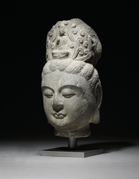 A GREY STONE HEAD OF GUANYIN
