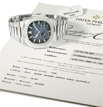 Patek Philippe A fine, rare and large stainless steel automa