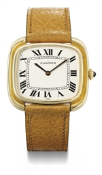 Cartier. An 18K gold oblong wr