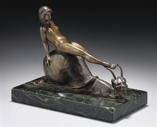A PATINATED BRONZE FIGURE, CIR